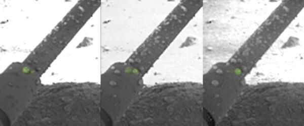 Gotículas de água no braço robótico da sonda Phoenix da NASA.