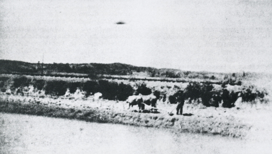 This is the only known UFO photo taken during the Vietnam War. It was shot with an Electro-35 Yashica camera by an American serviceman traveling in the back of an army truck along a country road near Chu-Lei in March of 1967 (image credit: UFO Photo Archives/Wendelle Stevens).