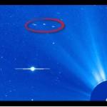 Três possíveis OVNIs / UFOs fotografados pelo satélite solar da NASA