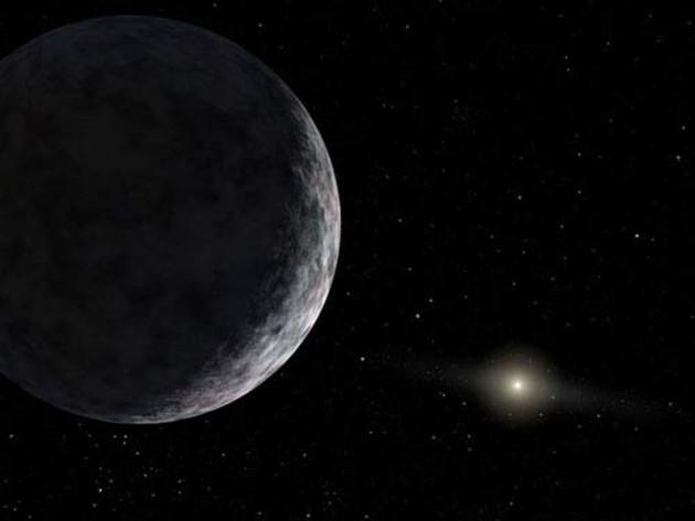 Concepção artística do planeta anão Eris. Astrônomos dizem que mundos maiores podem existir na beirada do sistema solar. Crédito: NASA / JPL / Caltech