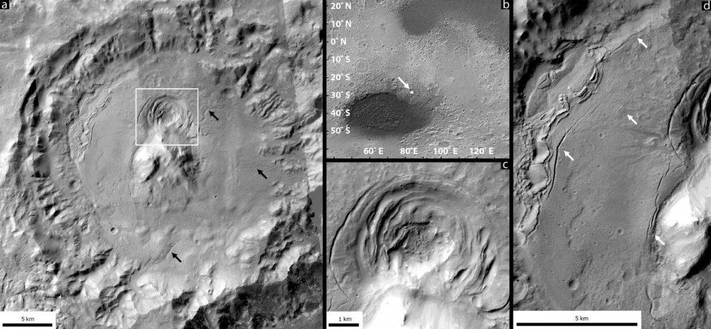 Uma das depressões, localizada dentro de uma cratera, na beirada da região da bacia Hellas, em Marte. Novas pesquisas sugerem que a depressão tenha sido formada por atividade vulcênaic abaixo da crosta de gelo - um ambiente favorável à vida microbiana. Crédito: Joseph Levy/NASA